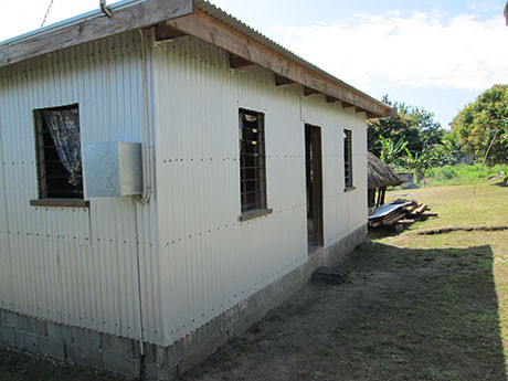 Joshua's new house (above) nearing completion. The electricity powers just a couple of small fluorescent lights but they are enough for the children to see to do their homework at night - Joshua's social welfare enables him to pay the bill.