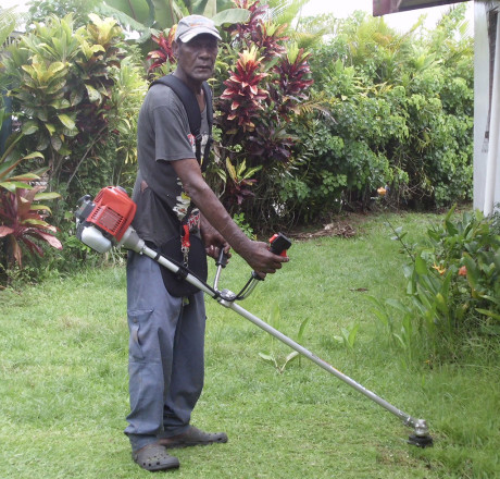 Josateki practices with his new brushcutter – the climate in Fiji ensures that he will never be short of work!
