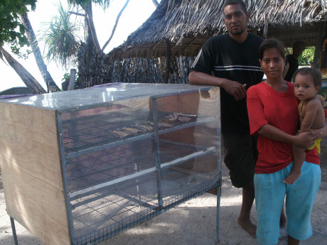 Kurarenga and her family with the fish dryer which has changed their lives.