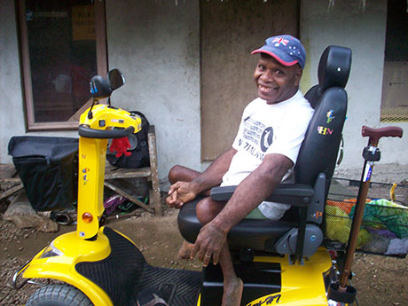 Isaac is disabled by polio and leprosy and used to rely on a hand pedalled wheel chair to get him up and down the steep road from his home to Luganville, the local town. Now he has this disability scooter his life has been transformed and he has been appointed President of the local disabled association. His wife Verongi helps Tony with the work of the Foundation.